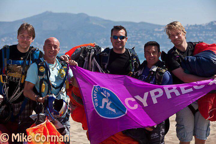 Regan posing with a group after a skydive.